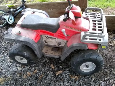 Older power wheels w/battery No charger