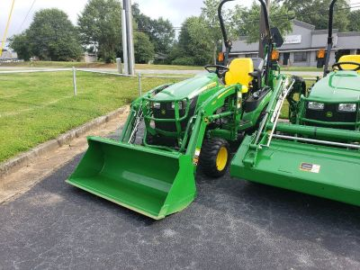 John Deere 1025R with backhoe