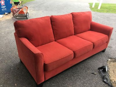 Red couch - Marcus Pointe Thrift Store