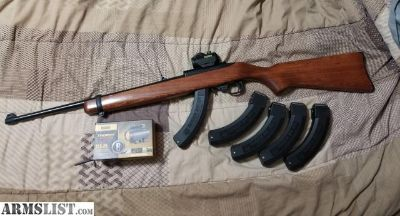For Sale: Ruger 10/22 with 5 factory 25 round factory mags and bushnell red dot