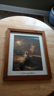 """Wood frame picture measures 18"""" by 22"""""""