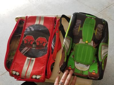 Kids zip open backpacks- adorable tracks inside. Tractor one is like brand new. Car one is in good condition. $5 for both