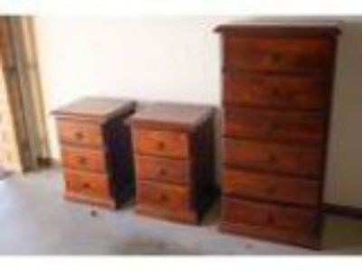 Dark pine bedside drawers and tall boy