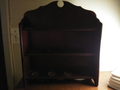 Solid wood shelf with indents for tea cups