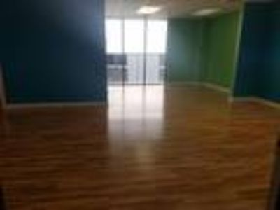 Large open room with private office. Wood floors, Easy lease