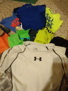 Boy's clothing selling as a lot T-shirt's Polo casual's nuteral and bright colors including Name brands like Under Armour and Nike