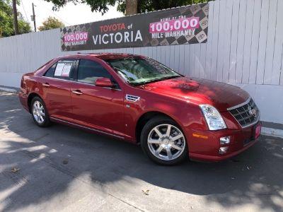 2009 Cadillac STS V6 (Crystal Red Tint)