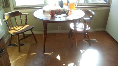 Table with leaves and 2 chairs