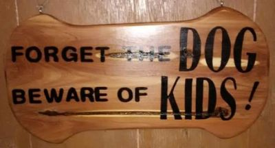Forget the dog beware of the kids!! Solid cedar wall decor.