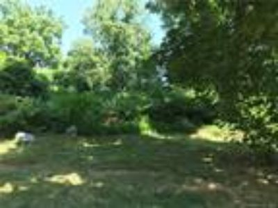 Bridgeport, Lovely Wooded Level Lot directly across from