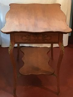 Beautiful antique oak side table with ormolu trim