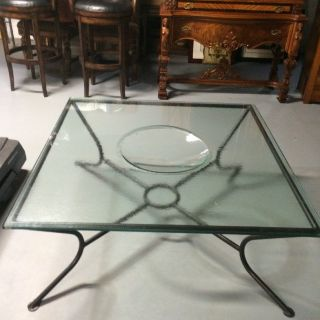 Glass coffee table with concave inset