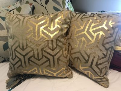 Set of two gold and beige pillows. Average size $5
