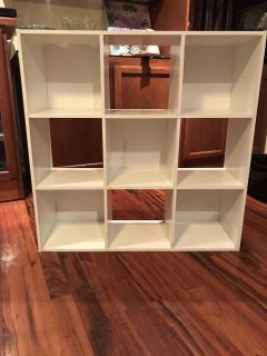EUC in the structure but has a few stains. Very sturdy 9 cube organizer. Above Landa Park.