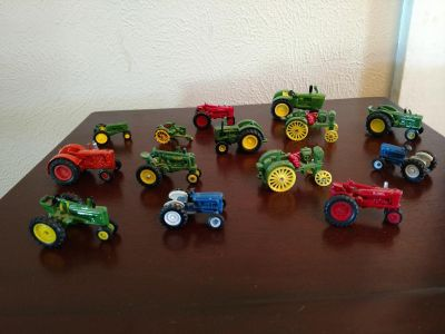 12 Miniature tractor collectibles. Excellent condition. Brenham pick up.