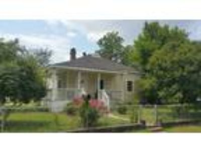 Columbia Three BR 1.5 BA, House on corner lot in Olympia.