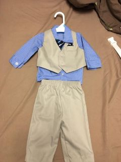 6-9 month suit-never worn