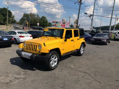 2015 Jeep Wrangler Unlimited Sahara 4WD 4dr Sahara (Baja Yellow)