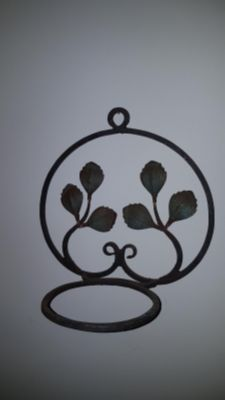 "Rustic style Wrought Iron wall-mount hanger for a planter. The opening is 5 3/4""."