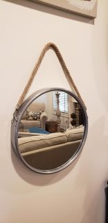 Nautical Port Mirror Hung with Thick Twisted Natural Rope.