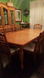 Dining room table 6 chairs & China cabinet .