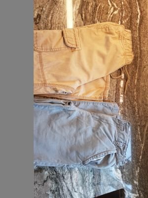 Two pairs of Oshkosh boys pants for $6. Both are size 10.