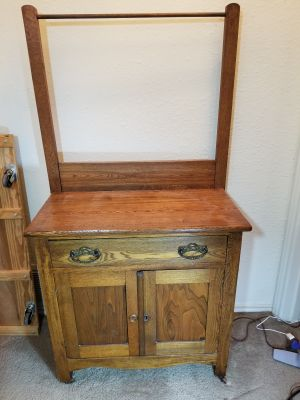 Impeccable antique solid oak hand wash stand with towel bar, dresser, side table