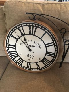 Double sided battery operated hanging clock