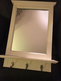 Wood framed wall mirror with hooks