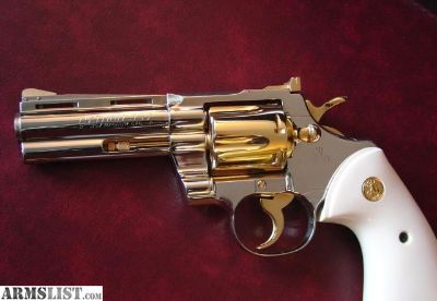 "For Sale: Colt Python 1960,4"" fully refinished in bright nickel with 24K gold accents,bonded ivory grips,357 magnum,nicer in person. awesome showpiece."
