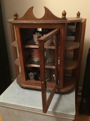 Wood curio cabinet with mirrors