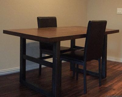 Dining Table with four leather chairs. Moving must go..