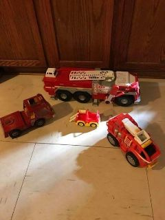 """makes sounds 29"""" X 7"""" Fire truck, 13X4 playsklool makes sounds,12X6 metal Rescue trck, & 7X3 truck"""