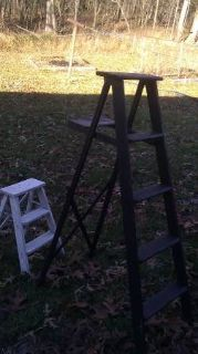 Antique ladders 1 big black and 1 small white
