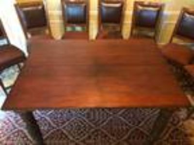 Good Extendable Wood Table and 7 Chairs