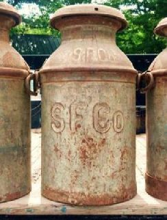 $75 Antique 15 gallon milk containers with lids