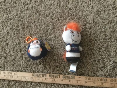 Set of 2 Broncos plushes, left is new with tags backpack clip, right is Bronco mascot. $2.00 takes the pair.