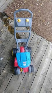 Kids bubble lawn mower.can either put bubbles in as mow or just follow behind parent and pretend mow.