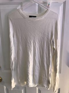 Off white light weight size large sweater with a few lint balls on it, nothing a lint roller won t fix. Very soft