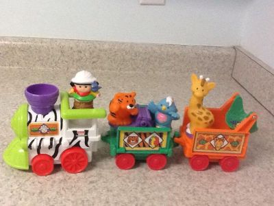 Fisher Price Little People Train & Animals . Train toots and plays music , giraffe spins & seesaw works when rolled.