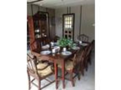 Dining room table with 8 chairs and Hutch. All dishes included.