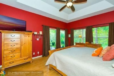 THIS HOME FEATURES VOLUME CEILINGS WITH A POPULAR LAYOUT INCLUDING MASTER BEDROOM DOWNSTAIRS
