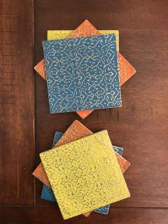 Coasters. 2 of each color: blue, orange, yellow. Cross posted.