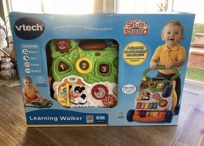 Vtech like new Learning Walker Sit to Stand