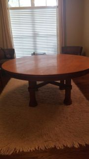 Solid, round antique table