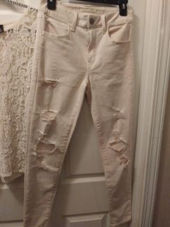 Very pale pink ripped pants