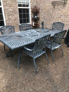 Wrought iron table,chairs and umbrella stand