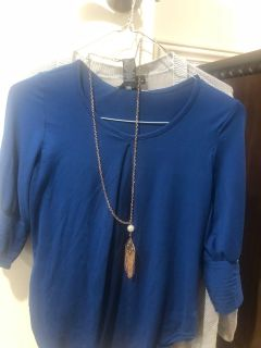 Royal blue top with necklace