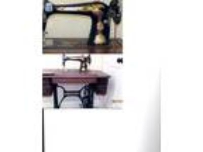 Antique Singer treadle sewing machine for sale.