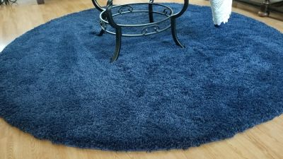 Beautiful like new navy plush area rug. Purchased back in fall and used in dining room which rarely used. Smoke and pet free home